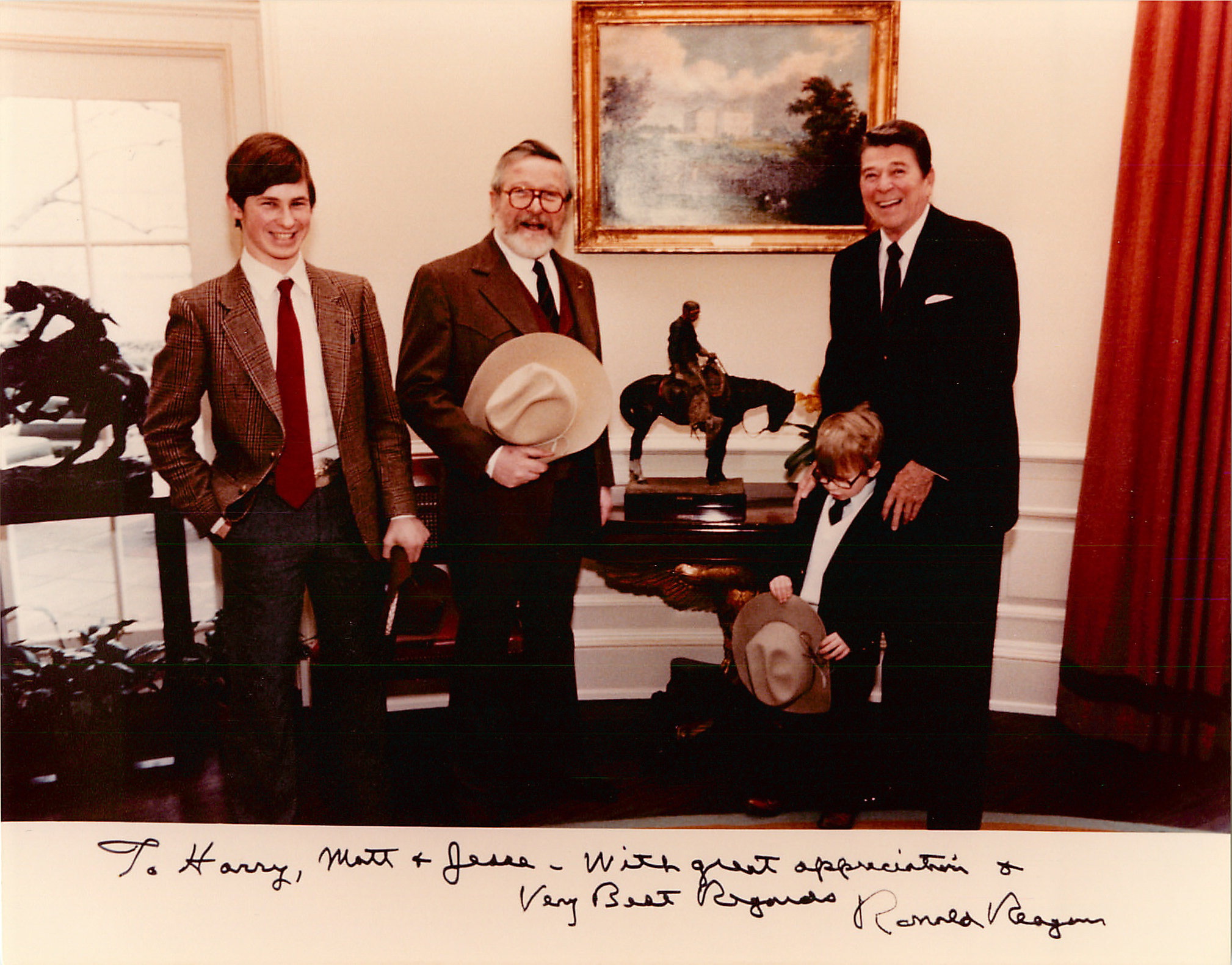 """1982 Harry, Matthew and Jesse Jackson meeting President Reagan in the Oval Office.  In the middle is """"Cowboy Meditation, Painted"""" by Harry Jackson"""