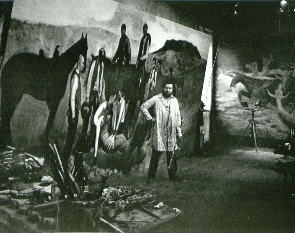 1961 Harry Jackson in Broom St Studio with unfinished Range Burial and Stampede paintings